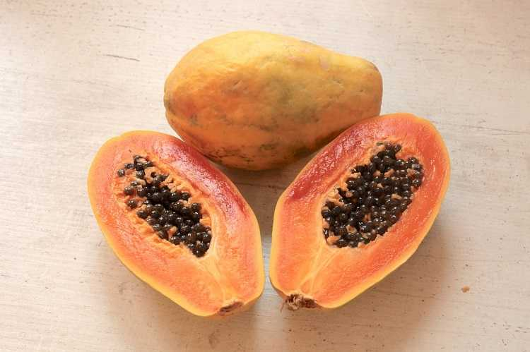 papaya fruit sliced in half