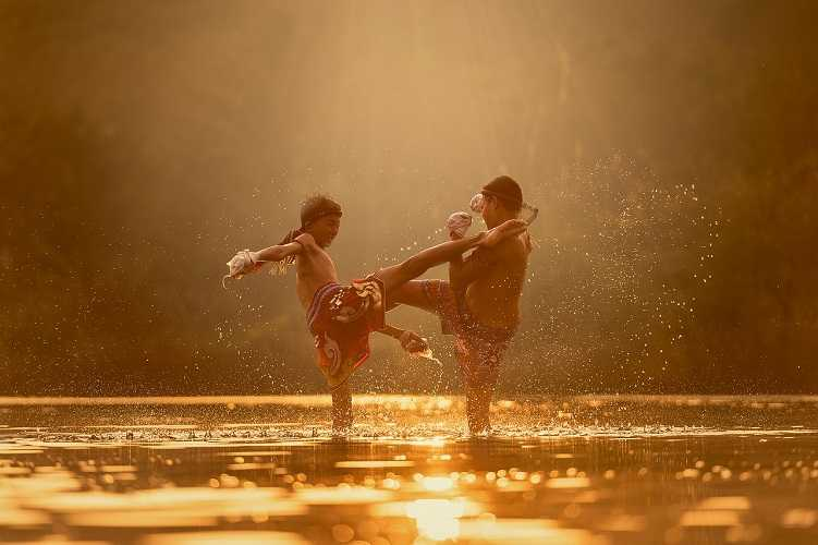 muay thai children in a river