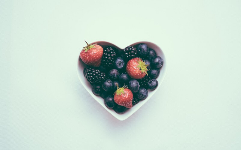 fruits in heart shaped bowl