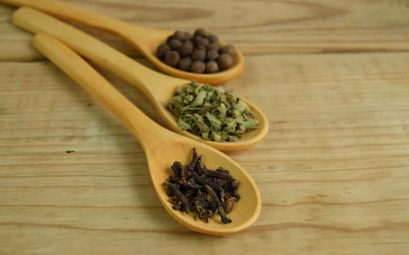 herbs in wooden spoons