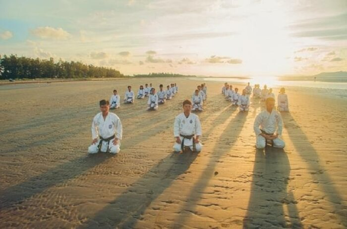 a group of people practising karate
