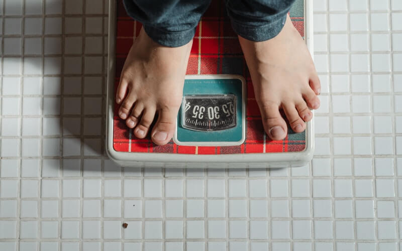 someone standing on a weigh scale
