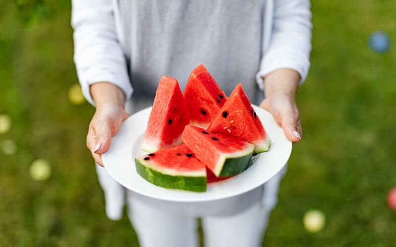A plate filled with sliced watermelons